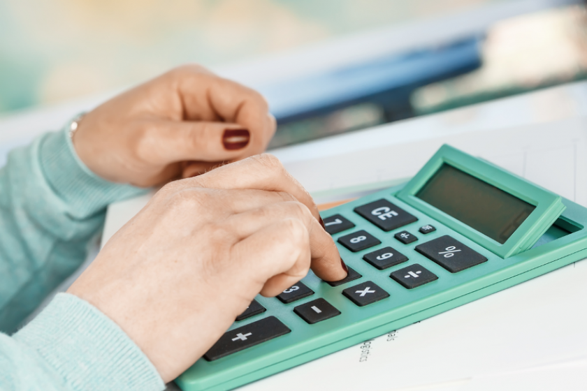 image of accountant using a calculator