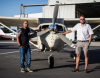 image of Promap staff members lined up in front of an aerial survey plane in South Africa